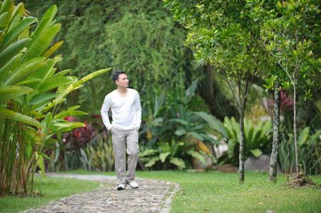 strolling: Man strolling alone in the park