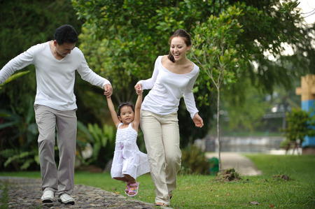 young asian couple: Happy Asian Family walking daughter in the park