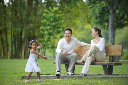 happy asian family: Happy Asian Family enjoying their time in the park