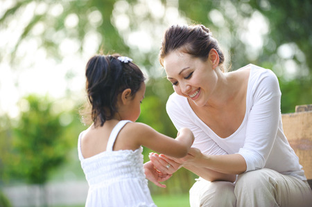 mother on bench: Mum and daughter spending time together in the park