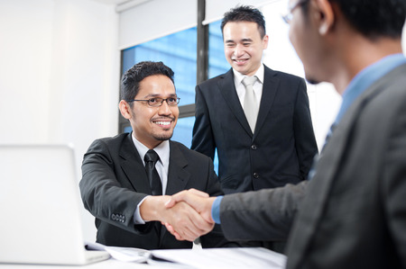 business transaction: Asian Business man shaking hands