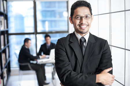 business transaction: Asian Business Man Smiling