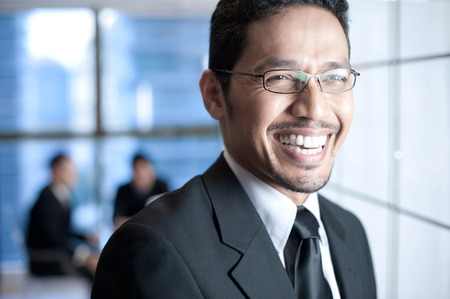 asian businessman: Asian Business man smiling happily