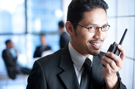 Business Man with walkie talkie Stock Photo