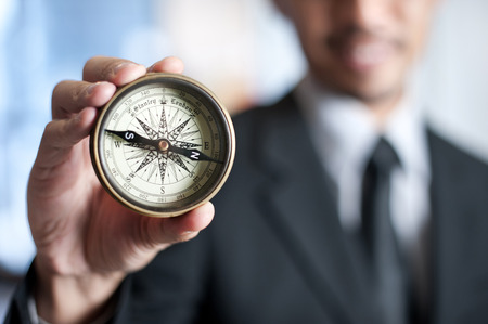Businessman with compass