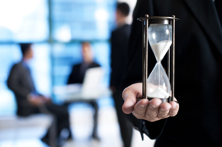 sand timer: Business man with sand timer Stock Photo