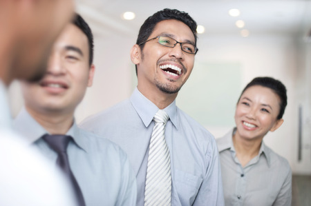 asian business people: Asian Business Man laughing with team