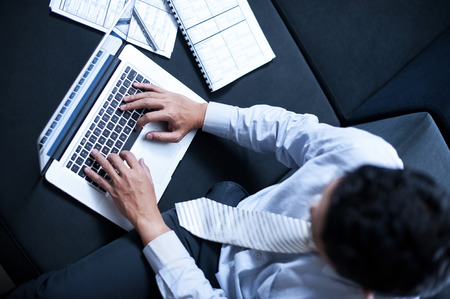 asian businessman: Asian Business Man working on a laptop Stock Photo
