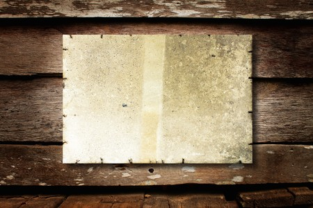 the western wall: old paper on brown wood texture with natural patterns Stock Photo