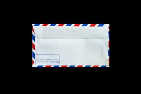 back side of envelope isolated on black photo
