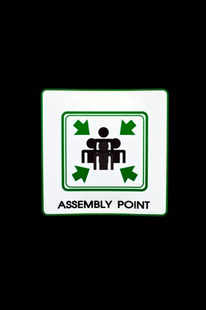 assembly point: assembly point sign isolate on black background Stock Photo