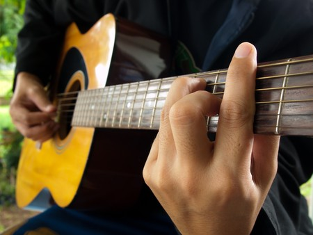 man playing folk guitar ,in the mood photo