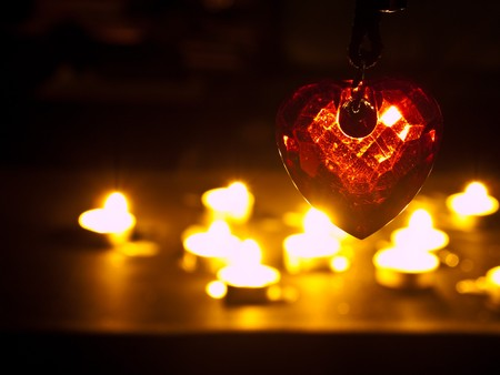 heart under: heart in crystal form under candle light Stock Photo