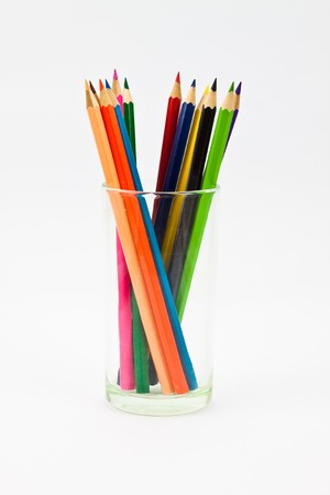 A clockwise standing pencils in a glass photo