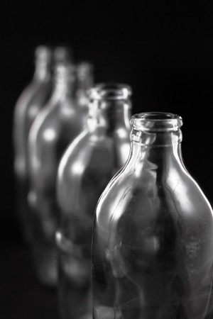 empty bottles collection, colorless, isolated on black background Stock Photo - 8116229