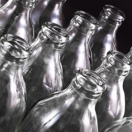 empty bottles collection, colorless, isolated on black background Stock Photo - 8116278