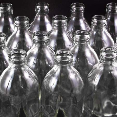 empty bottles collection, colorless, isolated on black background photo