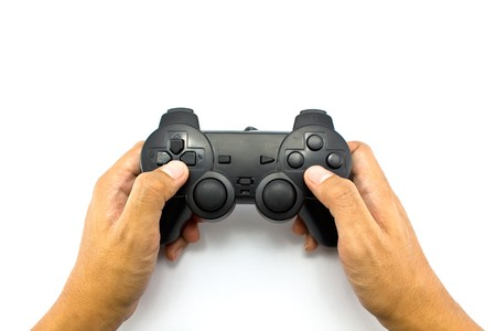 gamepads: The boy plays a computer game with the help joypad