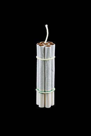 Cigarette Bomb isolated on a black background photo