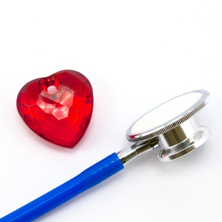 Heart and a stethoscope on a white background. Concept for cardiology. Stock Photo - 8325604