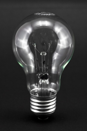 electric lightbulb isolated on a black background Stock Photo - 8325638