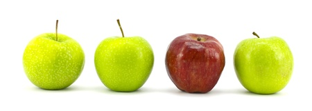 distinguish: green apple with the red one standing isolated on white background