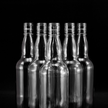 whisky bottle: empty bottles collection, colorless, isolated on black backgrounde