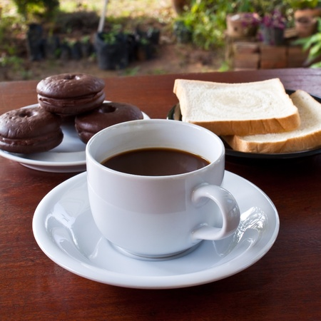 cup of coffee and bread on table