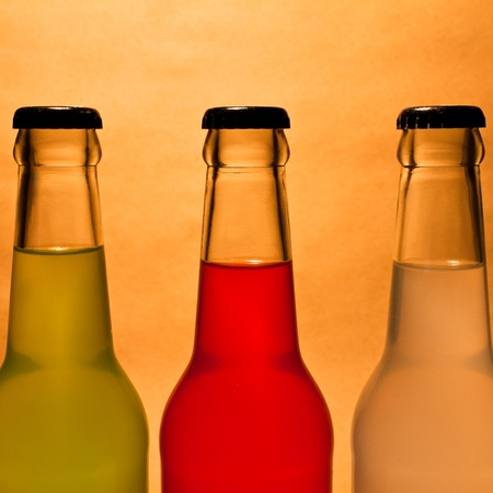 three colorful bottle of drink on vintage background photo