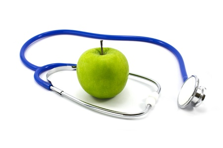 disease prevention: stethoscope and green apple isolated on white background Stock Photo