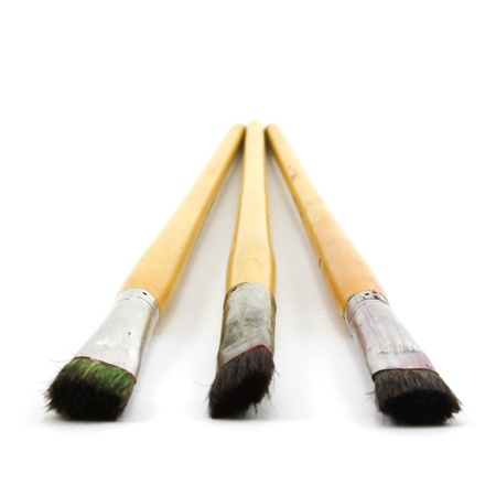 close up of paint brushes on white background photo