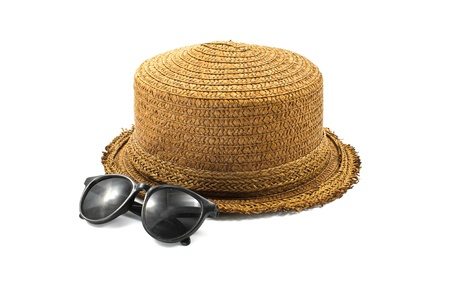 straw hat and sunglasses isolated on a white background photo