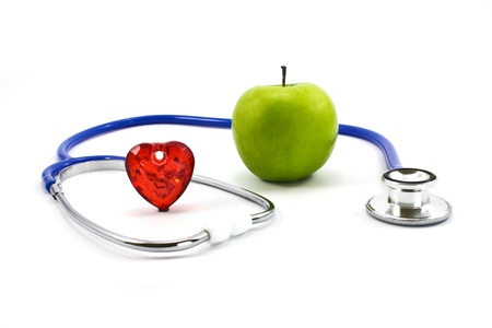 sound therapist: stethoscope and green apple isolated on white background Stock Photo