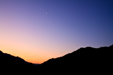 twilight: high mountain silhouette with beautiful colorful sky.