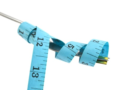Fork and measuring tape isolated on white photo