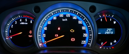 Modern car illuminated dashboard closeup photo