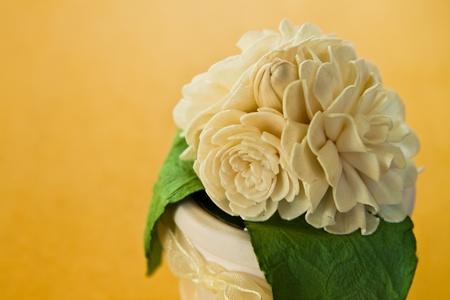 gift,jasmine and flowerpot on yellow background photo
