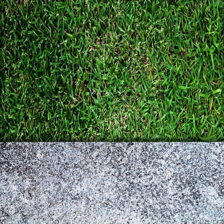 betonnen vloer en groen gras Stockfoto