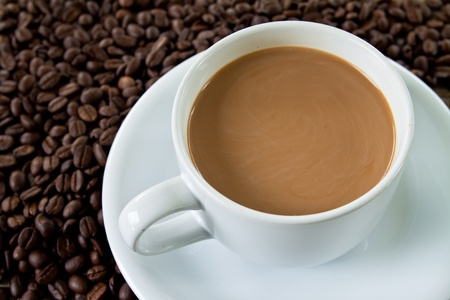 wei�er tee: Tasse Kaffee und Stack-Saatgut Lizenzfreie Bilder