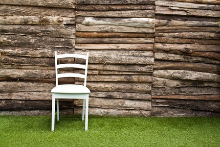 A white wood chair in living room on green grass Stock Photo
