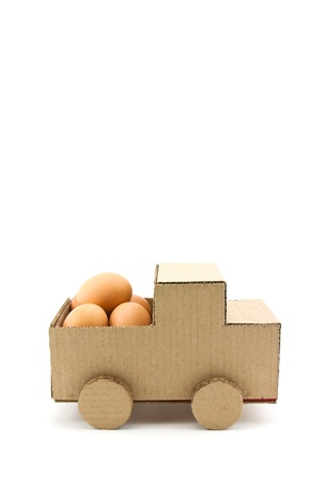 economize: The egg on car model isolated on white background Stock Photo
