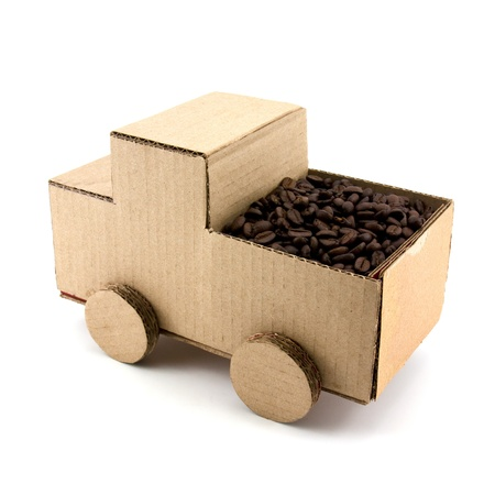 truck model made from Corrugated paper and stack of coffee bean Stock Photo - 10014712