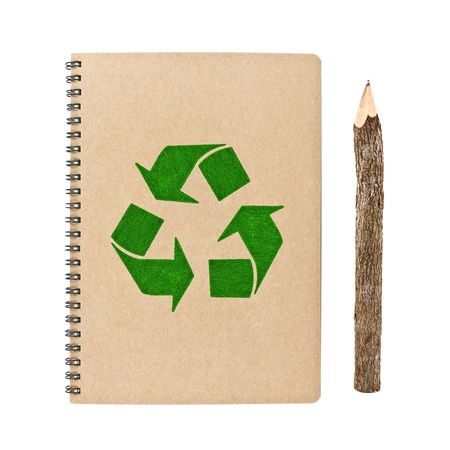 spiral binding: recycle notebook and wooden pencil isolated on white background, conservation concept