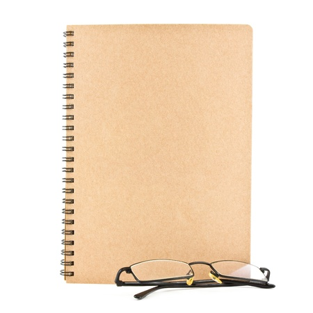 notebook and eyeglasses  isolated on white background, conservation concept photo
