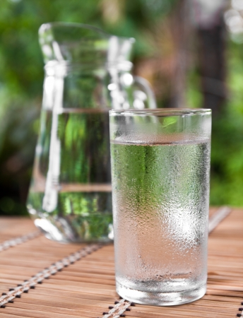 drinking water in glass on the table photo