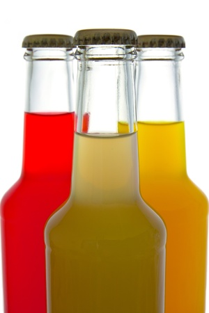 rainbow cocktail: three colorful bottle of drink on white background