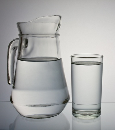 jug: drinking water isolated on gray background