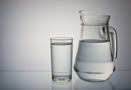 glass containers: drinking water isolated on gray background