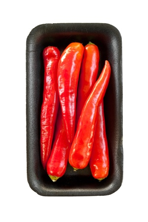 freigestellt: red chili on black tray isolated on white background
