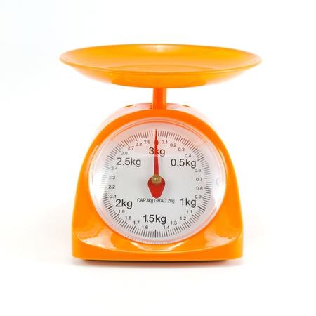 kg: orange steelyard isolated on white background Stock Photo